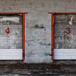 Old Grungy Industrial Garage Door with Graffitis. — Stock Photo
