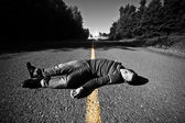 Empty Road With Dead Body in the Middle — Stock Photo