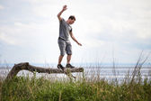 Young Adult Balancing on a Tree in Vacation — Foto de Stock