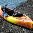 Orange and Yellow Kayak With Oars on the Sea Shore — Stock Photo #34881079