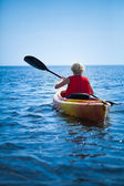 Woman Wearing a Safety Vest Heading out to sea Alone — Foto Stock