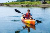 Man With Safety Vest Kayaking Alone on a Calm River — Stock Photo