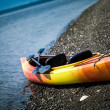 Orange and Yellow Kayak With Oars on the Sea Shore — Stock Photo #34903983