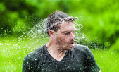 Young Adult Completely Drenched Shaking His head — Stock Photo
