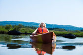 Woman Relaxing on a Kayak and Enjoying her Life — Stock Photo