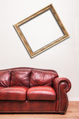 Luxurious Red Leather Couch in front of a blank wall — Stock Photo