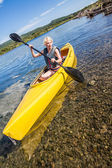 Calm River and Woman Kayaking in Gaspe, Quebec, Canada — Stock Photo