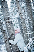 Lovely Girl Hugging a Tree in Forest (Ecology Concept) — Stockfoto