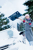 Car Stuck in the snow and a Woman Shoveling — Stock Photo