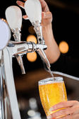 Pouring a Draft Blonde Beer from the Tap — Stok fotoğraf