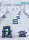 Snowplows and Cars on the Highway — Stockfoto