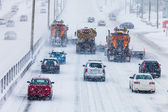 Tree Lined-up Snowplows Clearing the Highway — Stock Photo