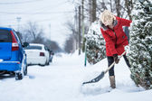 Woman Shoveling her Parking Lot — Stock Photo