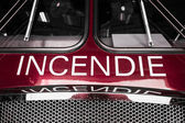 Red Firetruck Details of the Front with Wording — Stock Photo