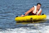 Teenager Tubing Behind Boat — Stock Photo