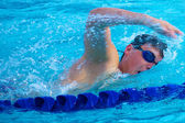 Swimmer Taking a Quick Breath Doing Freestyle — Stock Photo