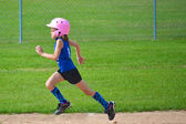 Young Girl Running the Bases in Softball at Full Gallup — Stock Photo