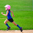Young Girl Running Bases in Softball — Stock Photo #22718975