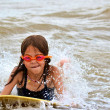 Young Girl Body Surfing at the Beach — Stock Photo #22719901