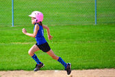 Young Girl Running Bases in Softball — Stock Photo