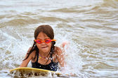 Young Girl Body Surfing at the Beach — Stock Photo