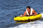 Teenage Tuber Sliding Across the Water — Stock Photo