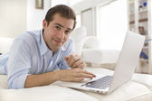 A man buys music online, at home — Stock Photo