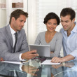 Financial consultant presenting a new project investment to a sm — Stock Photo