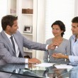 Real-estate agent giving keys to new property owners — Stock Photo #31463303