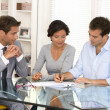 Couple with real-estate agent signing home investment contract — Stockfoto