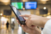 Close up of hands woman using her cell phone in station, backgro — Stock Photo
