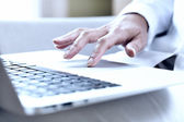 Female hands typing on a laptop trackpad — Stok fotoğraf