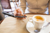 Close up of hands woman using her cell phone in restaurant,cafe — Stock Photo