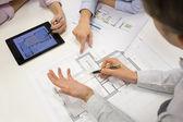 Architects using laptop — Stock Photo
