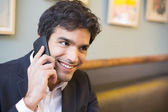 Businessman talking on mobile phone — Stock Photo
