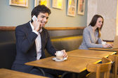 Businessman and businesswoman in coffee bar — Stock Photo