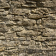 Old weathered stone wall — Stock Photo