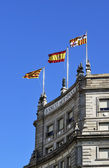Flags on Bank of Spain building. Barcelona — Stock Photo
