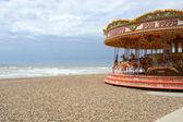 Fairground roundabout on Brighton beach. England — Stockfoto