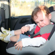 Stock Photo: Baby in car seat for safety, unhappy