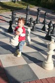 Baby boy playing chess — Stock Photo