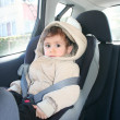 Stock Photo: Baby in car seat for safety, looking outside
