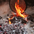 Burning coal ember fire and a pot at traditional turkish kitchen — Stock Photo