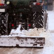 Stock Photo: Cleaning street from snow by tractor on street