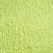 Towel green background — Stock Photo #25486875
