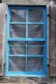 Old wooden barn window — Stock Photo