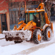 Cleaning street from snow by bulldozer on a street  — Stock Photo