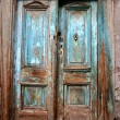 Antique old destroyed blue door — Stock Photo