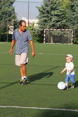 Playing football with dad — Stock Photo