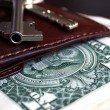 Banknotes, purse and keys — Stock Photo